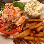Lobster roll with French fries and Cole slaw