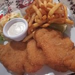 Real large portion of fried fish (snapper), chips and coleslaw