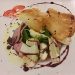 Think duck slices with porcini mushrooms