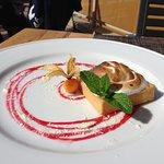 Lemon tart with raspberry coulis & white chocolate bits
