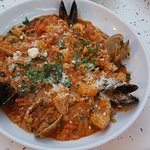 Seafood over risotto