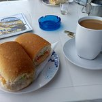 Cheese savoury roll and cup of tea