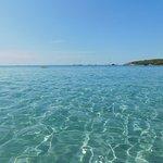 Photo de Spiaggia Porto Pino