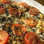 Napolitan pizza - A delicious mix of Colombian tomatoes and spices