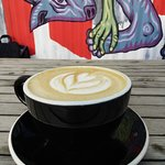 coffee with great mural behind