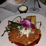 Plantain encrusted red fish with crab topping