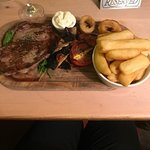 rib eye steak with trimmings and chips