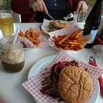 A pulled pork burger, a chicken burger, root beer float and hard cider with a side order of swee