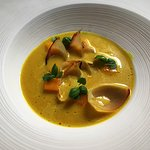Vegan lunch - baby onions, mango, and baby basil with curried coconut milk veloute