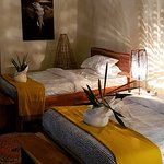 Warm comfortable rooms in an african thatched chalet