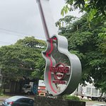 The iconic guitar on the main street in Playas del Coco