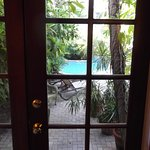 view of garden, patio & pool from Poinciana Patio room