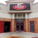 parking lot entrance to Noodles & Company
