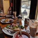 Hot chocolate, chai latte, quiche, and an hummus, cheddar and sun-dried tomato sandwich, tomato