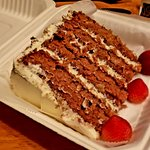 Amazing Carrot Cake!!!! That is a full size to-go box - it's huge and tastes amazing!