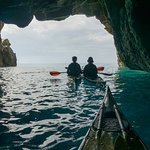 Enjoying the view to Gavdos island from a sea cave!