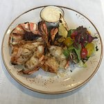 Butter garlic braised tiger prawns with garlic mayonnaise and salad