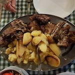 A main course of bones, fat and gristle (rib,neck etc) & potatoes