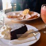 Sachertorte and grapefruit juice (pancakes/palacinka in background)