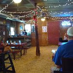 The inside dining room has sawdust on the floor and is airconditioned.