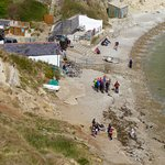 Boat Shed cafe and beach, viewed from hillside above.