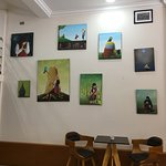 Gorgeous art make this cafe inviting and cozy.
