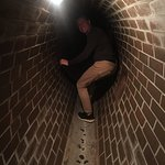 """David in the """"sewer system"""" at the Warsaw Uprising Museum. A powerful example of desperate heroi"""