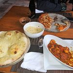 Madras curry with rice and naan, and four cheese pizza