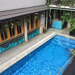 ...view of the pool from a veranda table