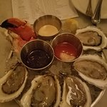 The crab claw was bland, the oysters devine