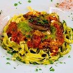 fillet steak with sobrasada salsa on a bed of fettuccine pasta