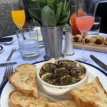 Escargots in the front, pigs in a blanket in the back + mimosa/bellini