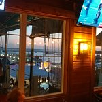 Table view of the marina with our team playing on the TV