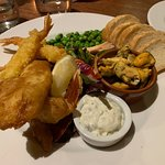 What a disappointment. Seafood platter was nice but the main was gristly over cooked pork with t