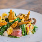 Black Angus Flat Iron with Avondale Jerusalem Artichokes and wilted greens.