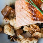 Salmon. Roasted Cauliflower, golden beets, currants and walnuts served with a brown butter.