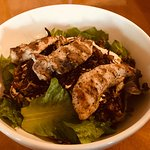 Muja Power Salad with Chicken - bed of greens, humus, grains, fried onions.