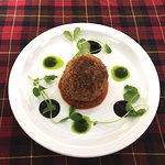 Haggis Scotch Egg with spicy tomato sauce