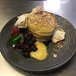 Delicious buttermilk pancake with berry compote, lemon curd & coconut crumb.. a must try!!