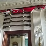 Swords and Guns festoons the foyer.