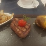 Fillet steak, sauteed onion and baked potato