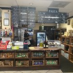 Order deli sandwiches and pasta at the counter.