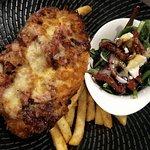 """Carmen's Killa"" chicken schnitzel, smoky Kilpatrick sauce, bacon, Mozzarella cheese, chips, Med"