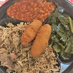 Pork plate with baked beans, collards, and hush puppies