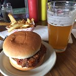 Meatloaf sandwich with excellent craft beer and fries.