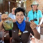 Guide Rubi offers moonshine at the woodworkers shop
