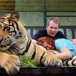 Us with the big tiger. This truly an experience that you don't want to miss.