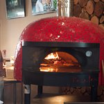 The hearth where the pizza is baked.
