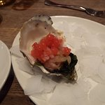 Oyster with red caviar