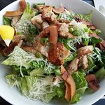 Chicken Caesar salad with Coconut Bacon.